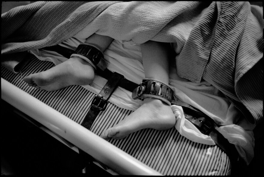 Feet in restraints, Ward 81, Oregon State Hospital. Salem, Oregon, 1976.