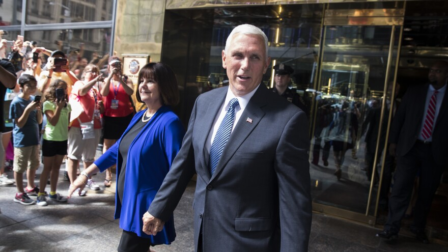 Indiana Gov. Mike Pence and his wife Karen leave a meeting with Republican presidential candidate Donald Trump at Trump Tower in New York on Friday, July 15, 2016.