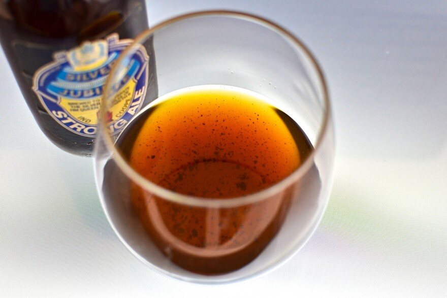 Sediment in a glass of 1977 Ind Coope Strong Ale. Proteins in very old beers can coagulate into chunks at the bottom of the bottle, Patrick Dawson explains in <em>Vintage Beer.</em>