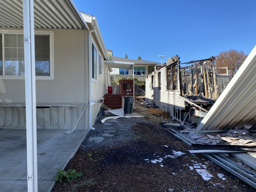 A manufactured home in Medford barely survived the Almeda Fire, but it took some damage.