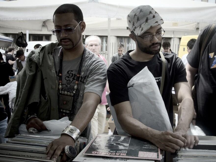 Madlib, left, and his colleague, J-Rocc, digging for records in 2009.