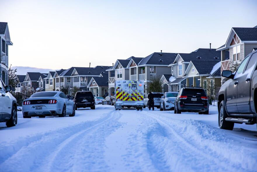 An emergency response vehicle drives through a San Marcos neighborhood on Monday as a massive winter storm swept through the state.