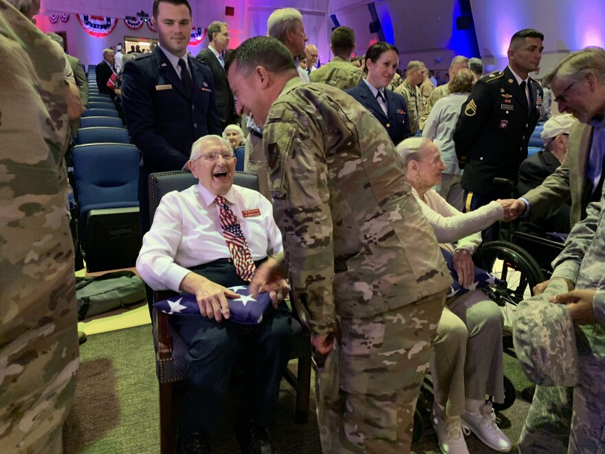 Lt. Bob McClintock of Seminole laughed as he shook hands with the dozens of service members who lined up to greet him and the other vets honored at MacDill's D-Day commemoration.
