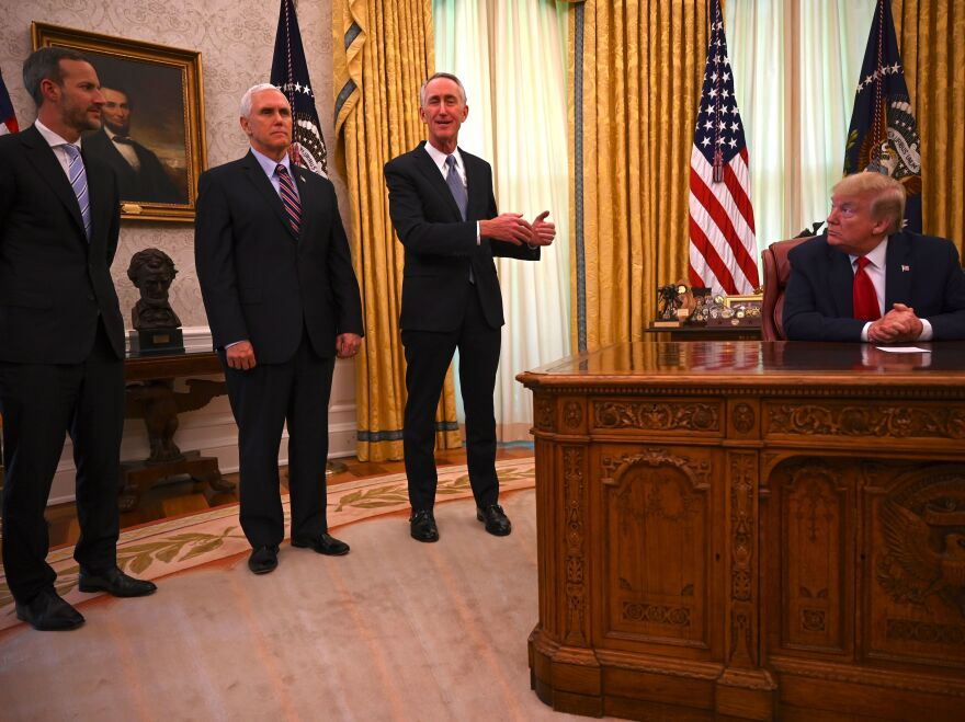 Adam Boehler, head of the DFC, helped the White House boost U.S. ventilator supplies. Here, he discusses plans in the Oval Office with Vice President Pence and Daniel O'Day of Gilead Sciences Inc.