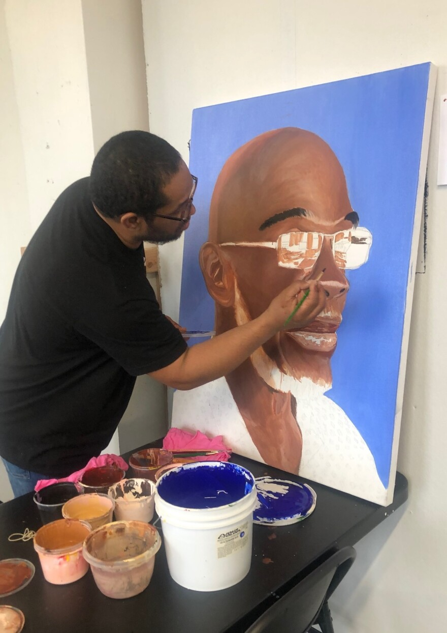 "James ""Yaya"" Hough works on a portrait of Michael ""Smokey"" Wilson, who was incarcerated for life as a child and served for 46 years."