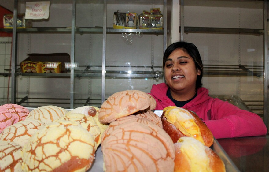Ana Rivera works at her family's bakery on Cherokee Street, where the concha pastry is a favorite.