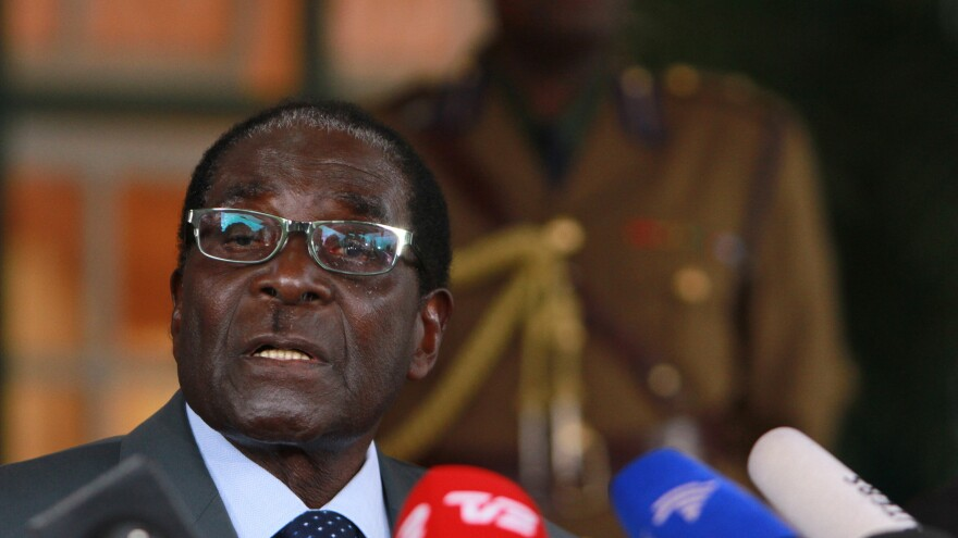 Zimbabwe's longtime President Robert Mugabe has been declared the winner in elections that give him another five-year term. He's shown here at a July 30 news conference.