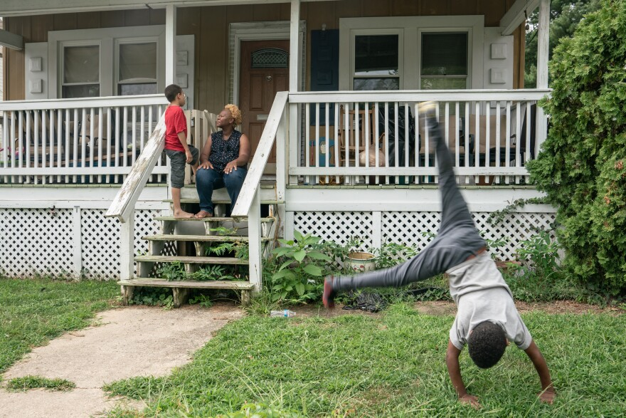 Desmukes shares time with her son Jonathan on the front porch of their home in Washington, D.C., while his brother Jeffrey does cartwheels. The boys say they're very excited that the coming baby's going to be a boy, too.