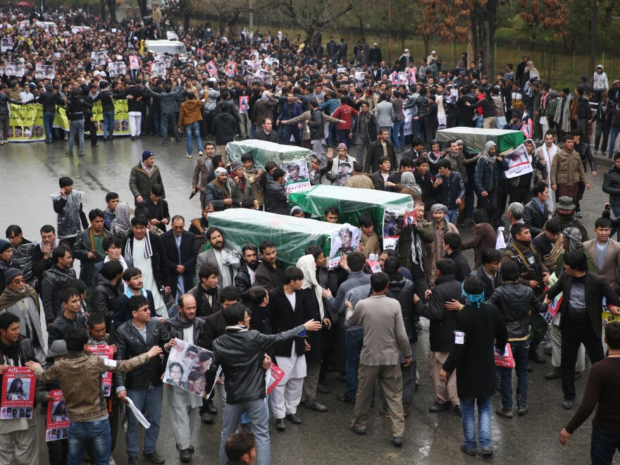 Protesters march through the Afghan capital of Kabul on Wednesday, carrying the coffins of seven ethnic Hazaras who were allegedly killed by the Taliban. The demonstrators called for justice and for a government that can ensure security in the country.