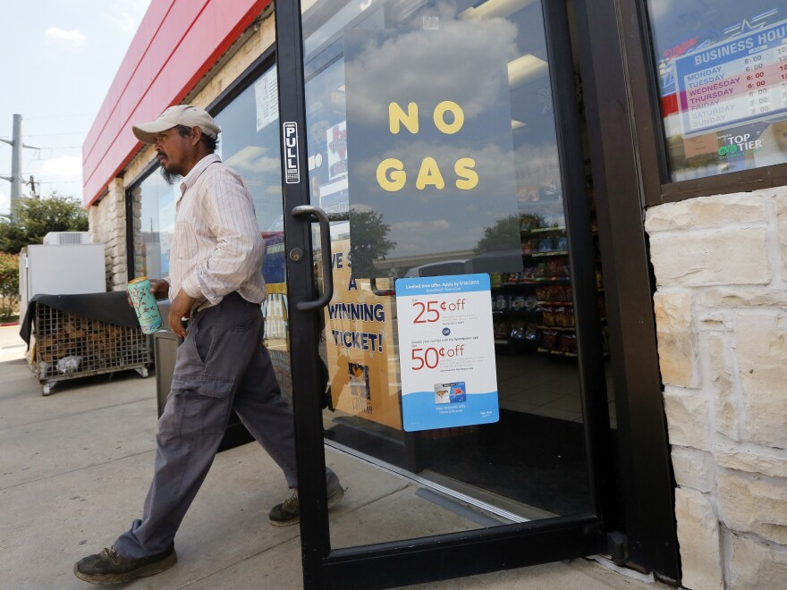 A customer walks out of an Exxon station in Bedford, Texas, Thursday. Refinery shutdowns have sent prices up all over the country.