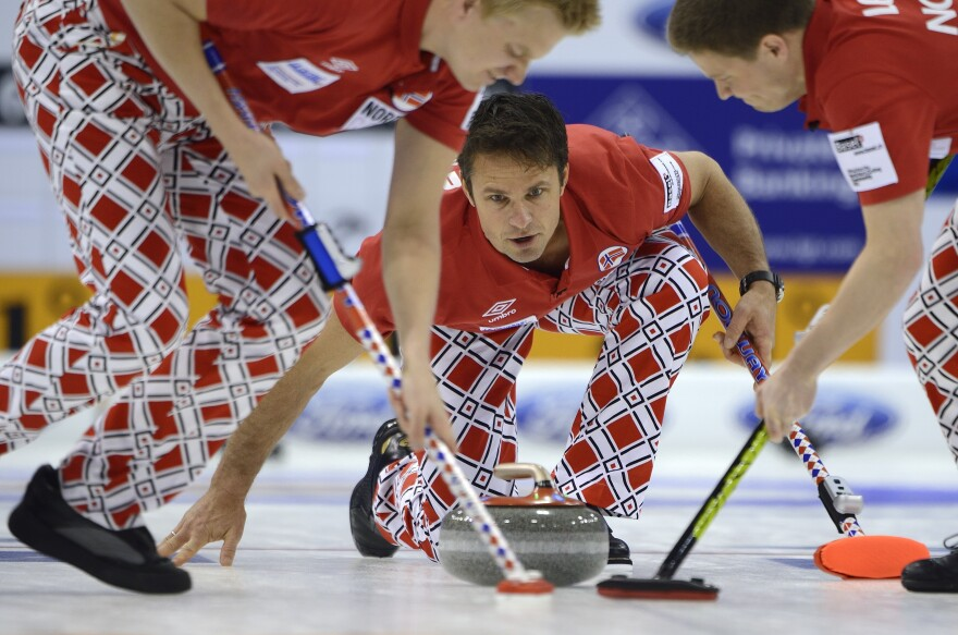 For some, the chance to watch curling is a reason to be excited about the Sochi Winter Olympics. Here, Norway's Thomas Ulsrud delivers a stone during the 2012 World Men's Curling Championship.