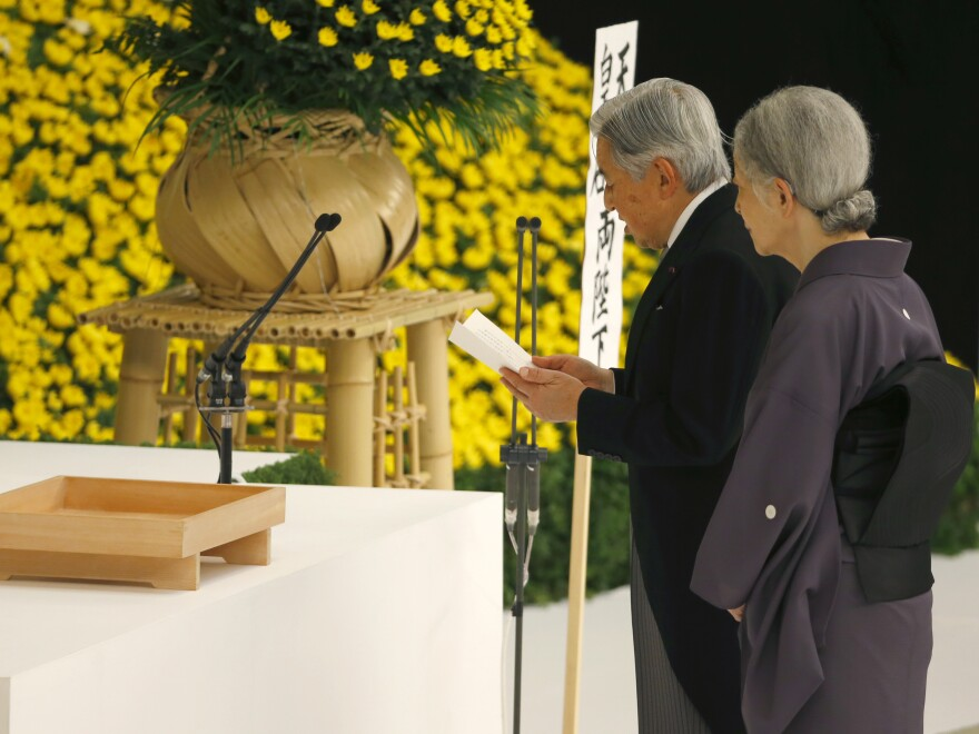 "Japan's Emperor Akihito delivers his remarks with Empress Michiko during a memorial service at Nippon Budokan martial arts hall in Tokyo, on Saturday. His expression of ""deep remorse"" for Japan's wartime past is seen as an unprecedented apology."