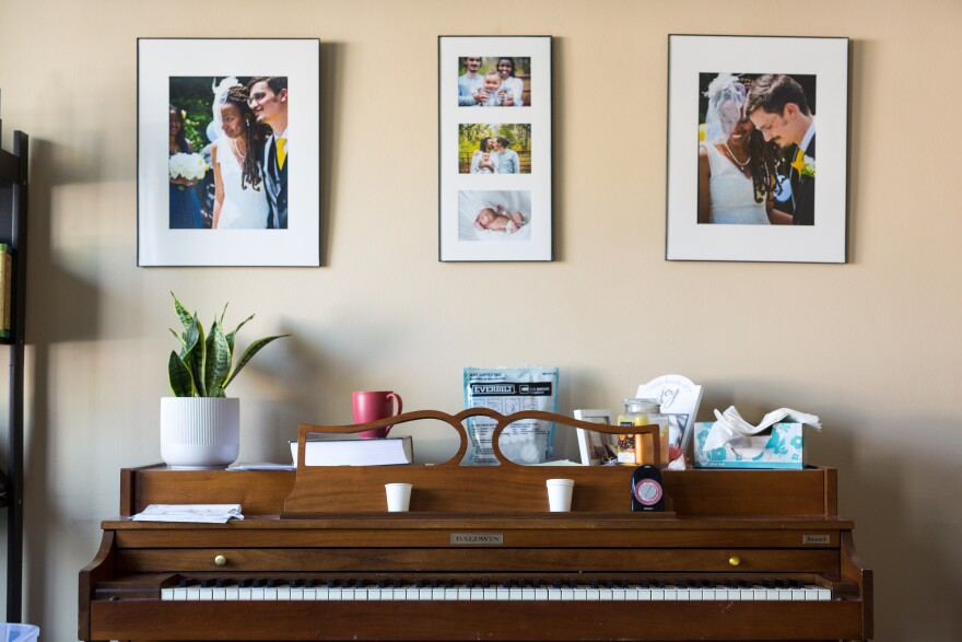 Wedding photos and birth announcement photos are displayed above a piano. The couple says they were lucky their family, friends and pastor talked about sex in an open, nonjudgmental way.