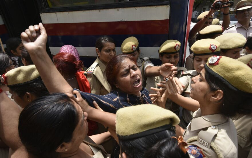 Police detain women during a protest in front of the Supreme Court building in New Delhi in May. The demonstration was in response to Chief Justice Ranjan Gogoi's exoneration in a sexual harassment case.