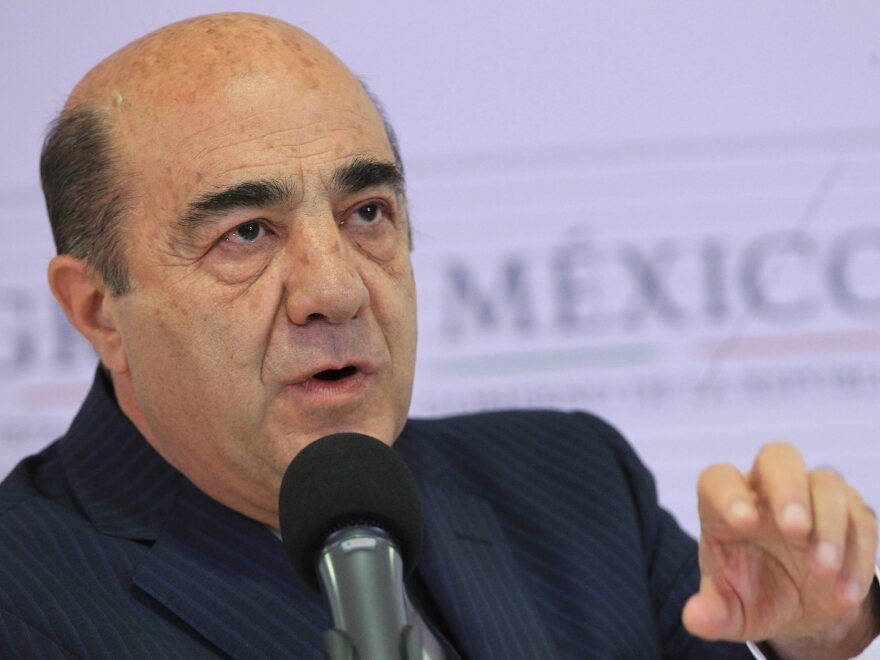 Mexico's Attorney General Jesus Murillo Karam addresses a news conference in Mexico City on Friday. He announced the arrest of three suspects in the brutal slaying of 43 students in the country's south.