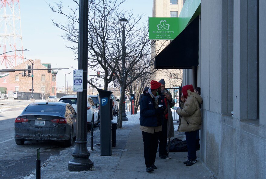People staying at the downtown safe haven shelter in St. Patrick Center take a smoke break on Feb. 12, 2021 morning.
