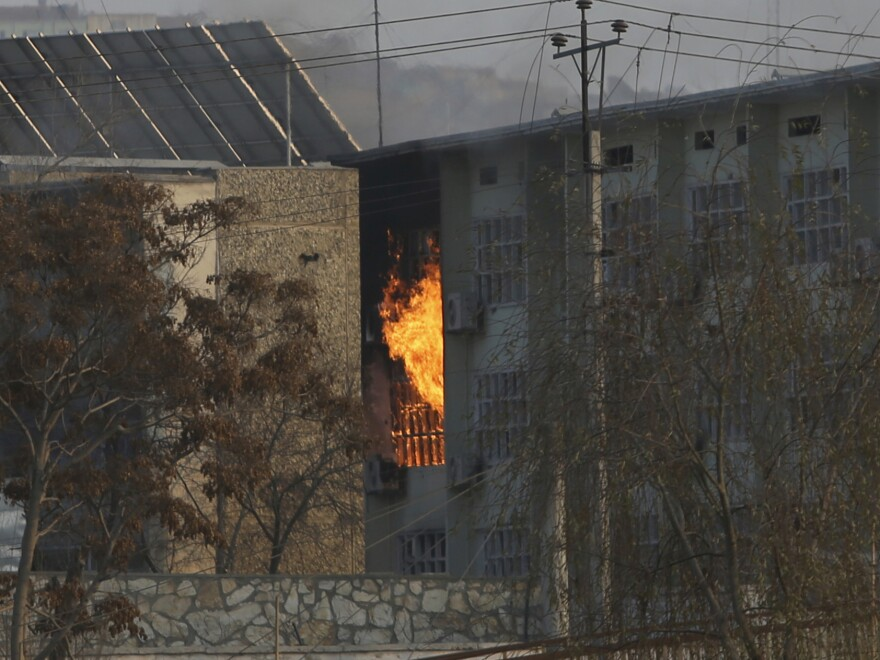 Flames rise from a government building following a suicide bombing and attack by gunmen on Monday in Afghanistan's capital.