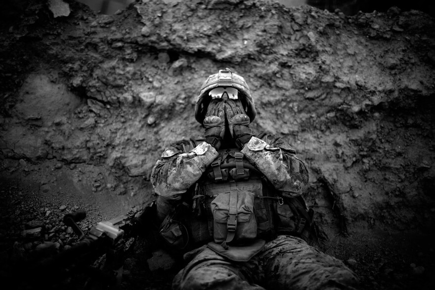 Marine Lance Cpl. Anthony Espinoza wipes the sweat out of his eyes at the end of a daylong patrol out of the Sangin District in southern Afghanistan in 2011.