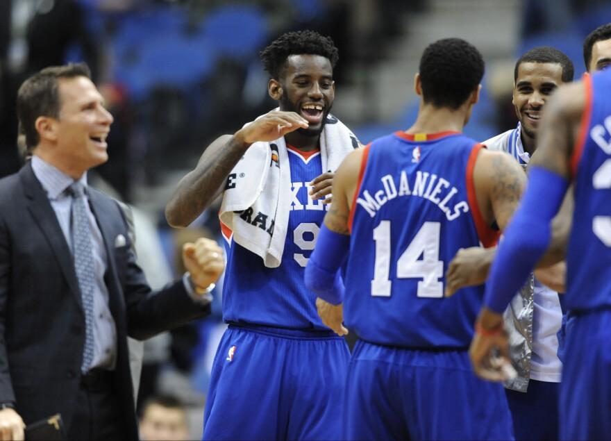 Philadelphia 76ers forward JaKarr Sampson congratulates guard K.J. McDaniels during the fourth quarter of Wednesday's NBA basketball game against the Minnesota Timberwolves.