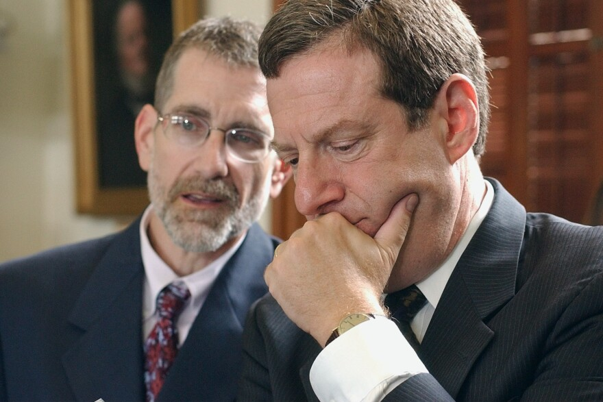 Sandy Kress (right) an attorney from Dallas, listens to Texas Education Agency general counsel David Anderson in 2004. Kress was the chief education consultant to the Bush administration's No Child Left Behind initiative.