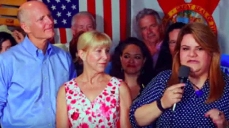 Puerto Rico's resident commissioner representative to the U.S. Congress, Jenniffer Gonzalez-Colon (right) in a TV ad for the Senate campaign of Florida Governor Rick Scott (left)