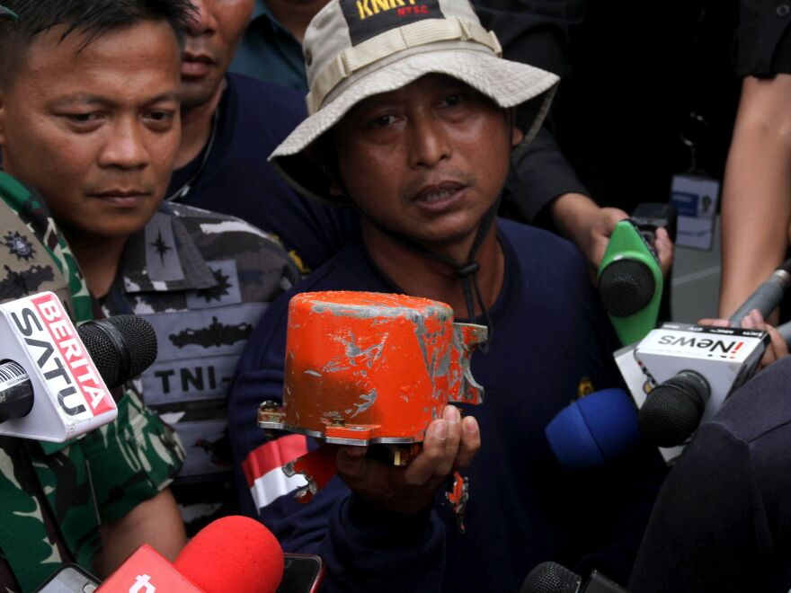 The cockpit voice recorder from Lion Air Flight 610 is displayed by Indonesian navy personnel after the device's recovery on Monday.