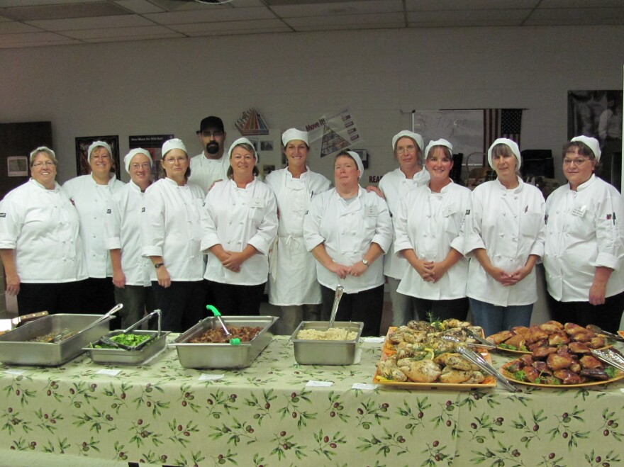 Kathy Del Tonto (far right) participates in a class that teaches school cafeteria workers how to prepare meals from scratch.