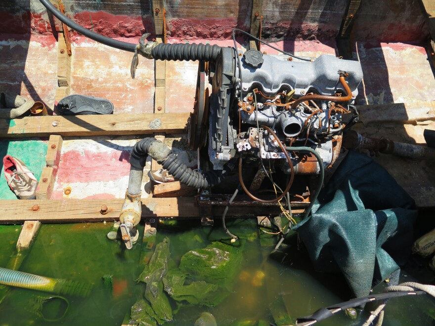 """The interior of a """"chug"""" shows the engine along with sneakers and other debris from the migrants' trip."""