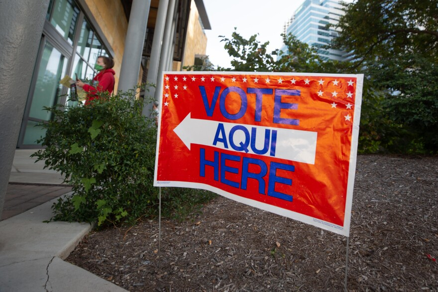 Lines for voting on day one of early voting for the 2020 elections at the the Austin Central Library.