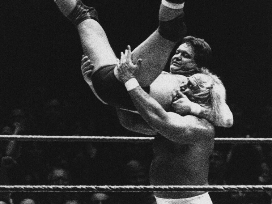 "Wrestler Hulk Hogan prepares to slam ""Rowdy"" Roddy Piper down on the mat during the first WrestleMania in March 1985 at New York's Madison Square Garden."