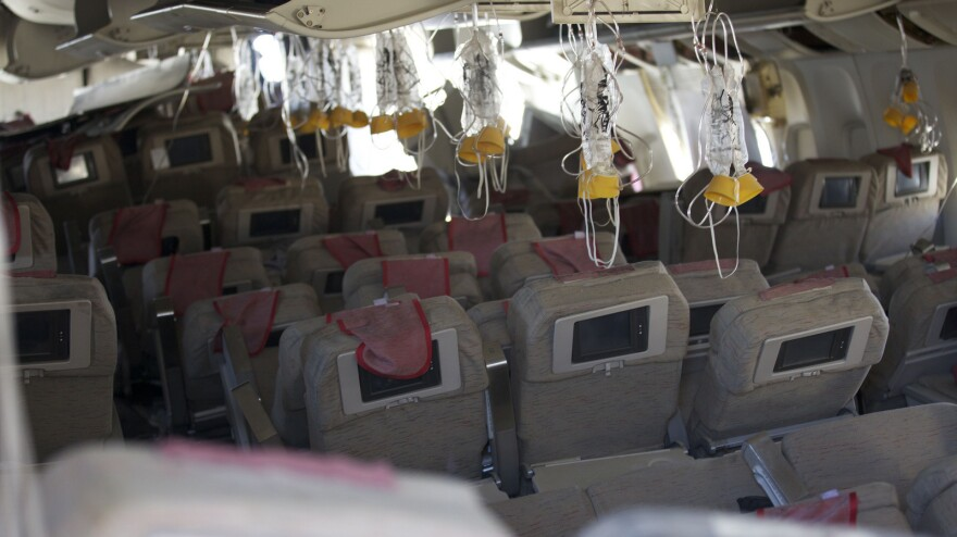 A photo published by the NTSB shows the interior of Asiana Airlines flight 214, which crash-landed at San Francisco's airport Saturday. The investigation into the crash, which killed two people, is continuing.