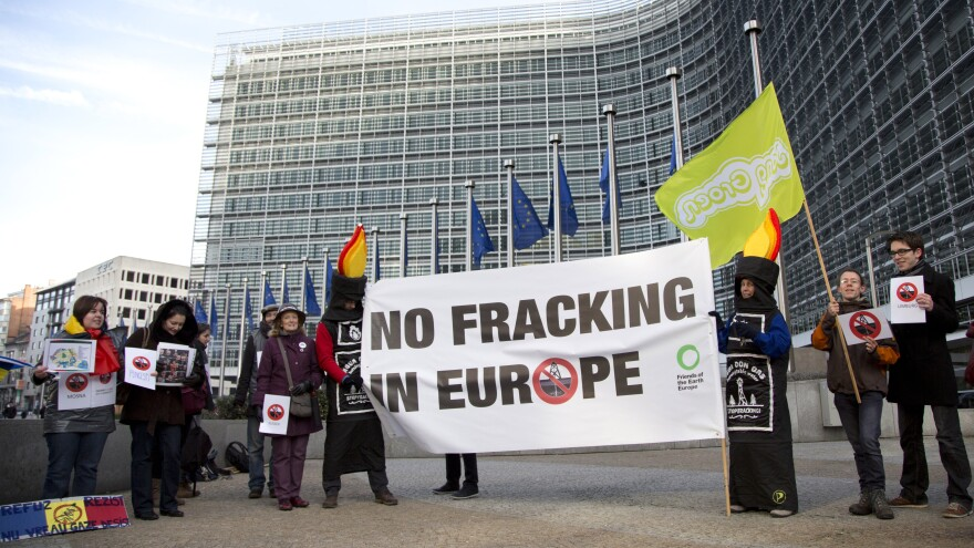 Many countries in the European Union are drawn to the benefits of fracking: cheap energy and energy independence. But many Europeans, including these protesters standing outside EU headquarters in Brussels, object to the practice on environmental grounds.