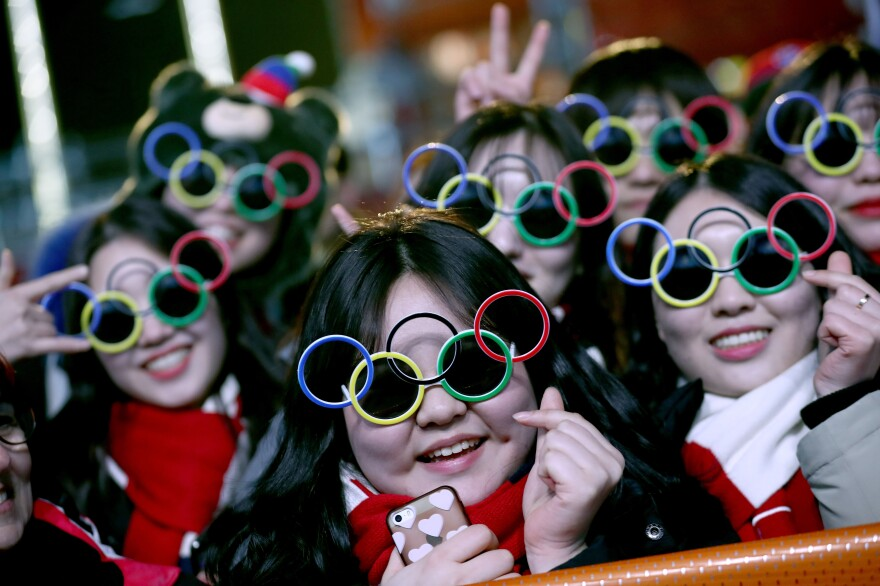 Fans wear Olympic ring glasses during a medal ceremony on Feb. 18. The medals were given out in nightly ceremonies, so winners were given stuffed tigers right after their victories.