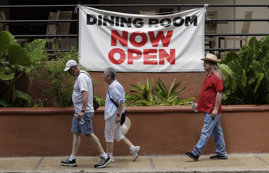 Visitors walk along the River Walk in San Antonio, Monday, June 15, 2020, in San Antonio. Many restaurants and business that have been closed due to the COVID-19 pandemic are reopened.