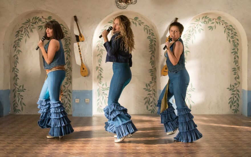 """Left to right: Young Tanya (Jessica Keenan Wynn), Young Donna (Lily James) and Young Rosie (Alexa Davies) in """"Mamma Mia! Here We Go Again."""" (Courtesy Universal Pictures)"""