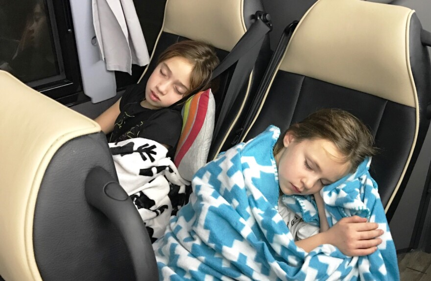 Izzy Shew of Lake St. Louis and Lillie Baker of Des Peres didn't seem to have a problem sleeping on the bus to Washington on January 21.