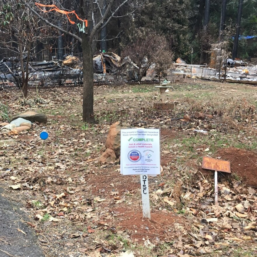 A sign marking a property in Paradise indicates that hazardous household items have been removed. But toxins in the ash and debris remain a concern.