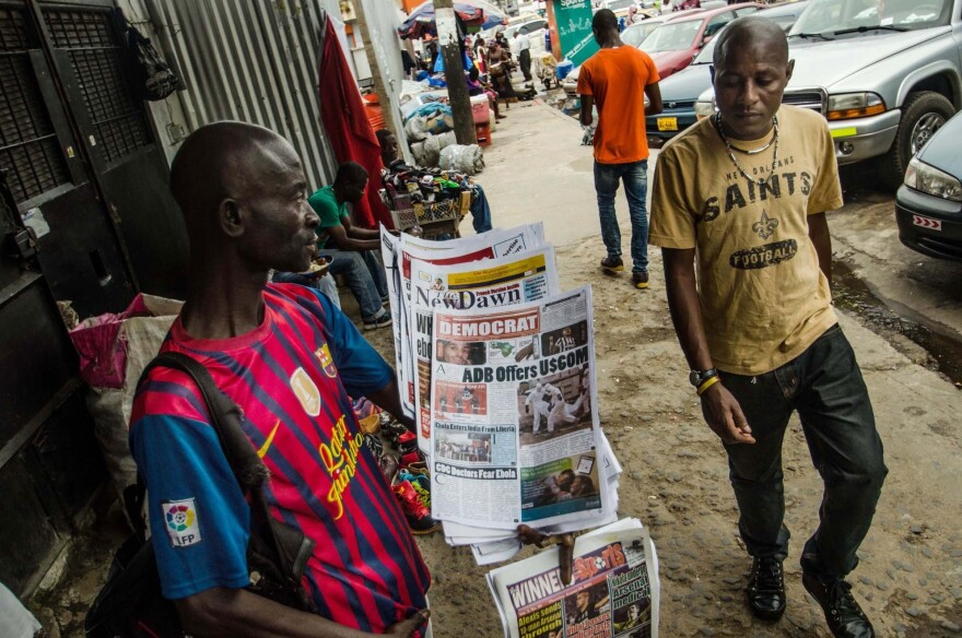 Not every business has been hurt by the Ebola epidemic: Stephen Kollie says his newspaper stand is thriving because people are hungry for the latest Ebola information. But many of his usual expatriate customers have left the country, he says.