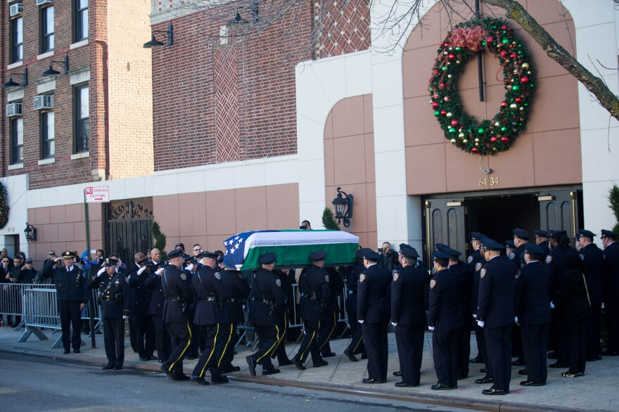 Ramos' casket is carried into the church.
