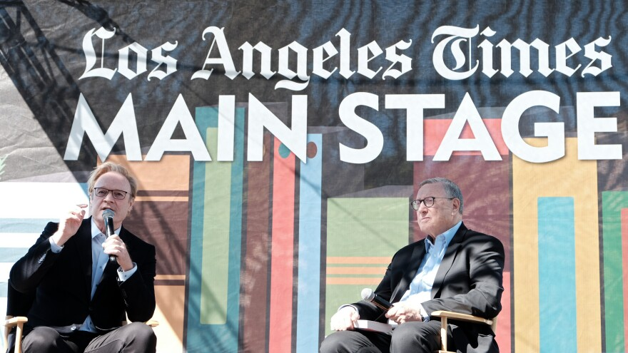 <em>LA Times</em> Executive Editor Norman Pearlstine (right) listens to actor Lawrence O'Donnell at the 2019 Los Angeles Times Festival of Books in April 2019.