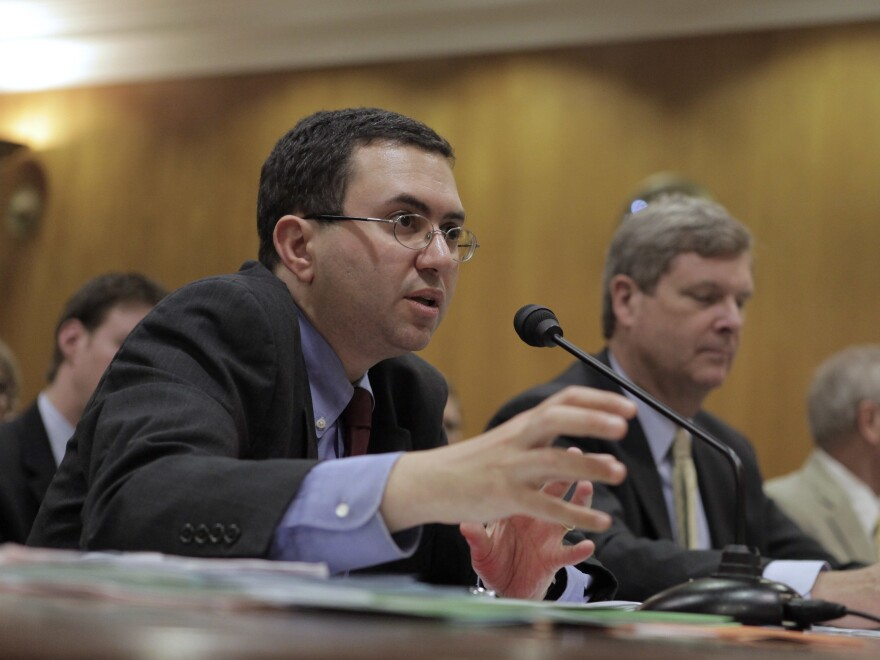 Former Principal Deputy Commissioner of the Food and Drug Administration Joshua Sharfstein, left, testifies on Capitol Hill in 2009 on swine flu.