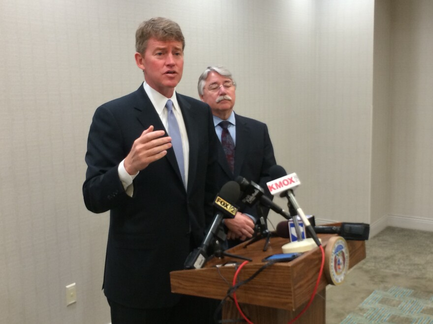 Missouri Attorney General Chris Koster and Indiana Attorney General Greg Zoeller talk with reporters last week in Brentwood. Koster endorsed Amendment 5 last year -- even though many Democrats vigorously opposed it.