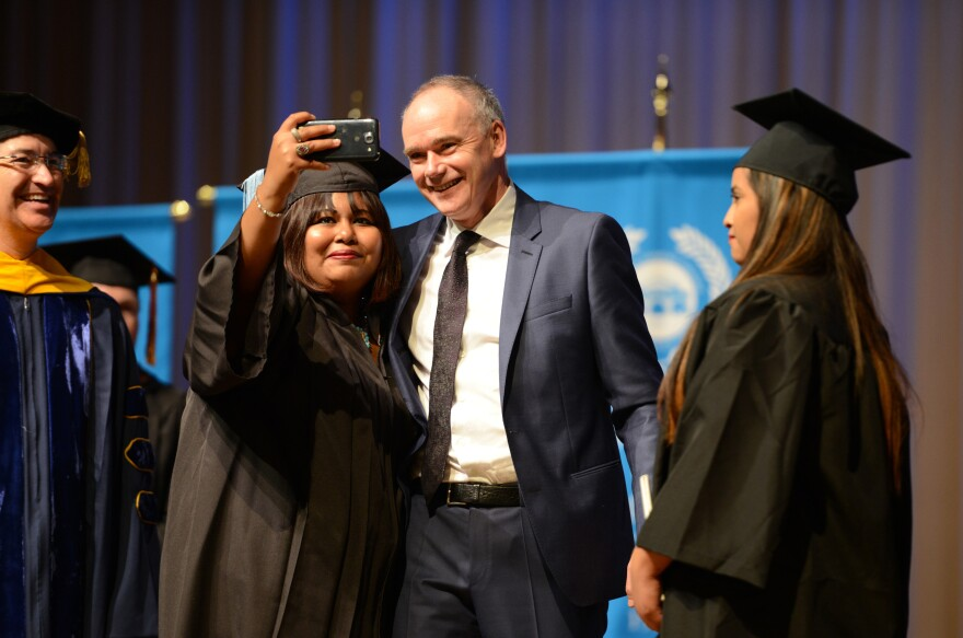 Students pose for a selfie with John Fallon, the CEO of Pearson in Brownsville, Texas, on May 16. Fallon delivered the commencement address to more than 300 students at Texas Southmost College in Brownsville.