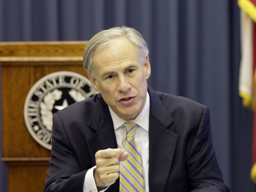 Texas Gov. Greg Abbott is one of a growing number of state leaders who oppose efforts to resettle Syrian refugees inside their states. He is shown here during a meeting with reporters in June.