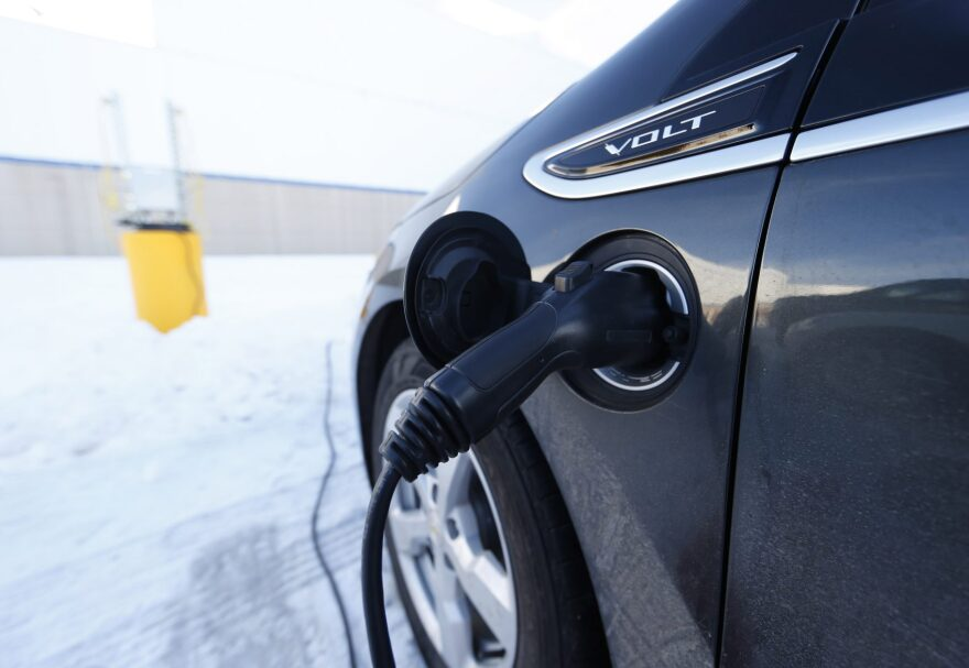 A Chevrolet Volt is plugged into a charging station Monday, Feb. 8, 2016, in Denver. (David Zalubowski/AP)