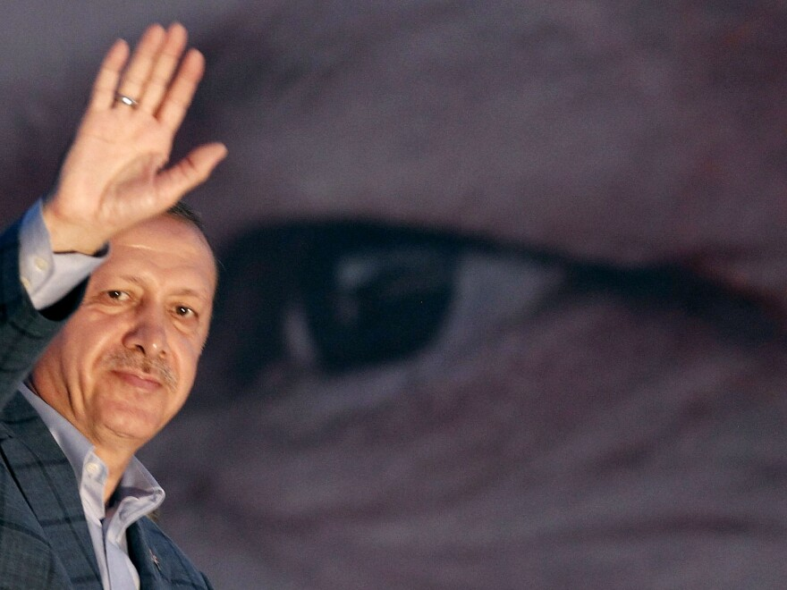 """Turkey's Prime Minister Tayyip Erdogan waves to the crowd in Istanbul on Sunday. He said the Turkish people had """"shown their will"""" in electing him president."""