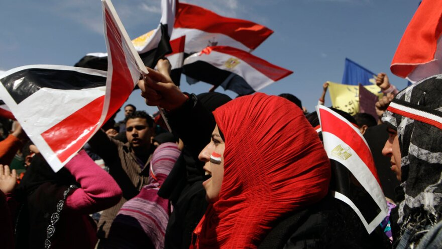 Women chant slogans and wave the Egyptian flag during a rally March 11 to support national unity of Muslims and Christians in Cairo's Tahrir Square, the focal point of the uprising that ousted Hosni Mubarak.
