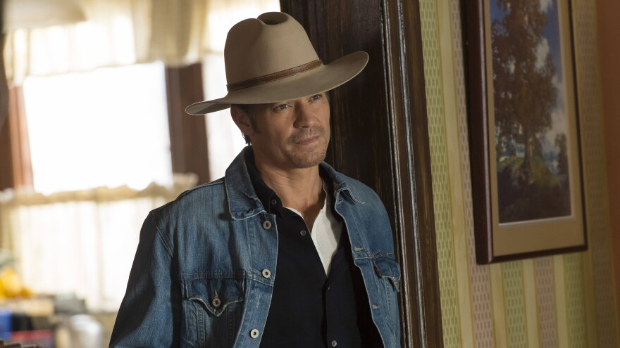 """Timothy Olyphant plays Deputy U.S. Marshal Raylan Givens on FX's <em>Justified</em>, which is based on a novella by Elmore Leonard. The show's creator, Graham Yost, says the only """"tussle"""" the writers had with Leonard happened during the pilot, over which hat Raylan should wear."""