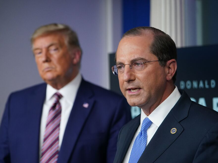 Alex Azar, current secretary of Health and Human Services, spoke alongside President Trump on the issue of drug pricing in November. Azar's staff issued a rule Nov. 4 that critics say is meant to repeal regulations and bog down the incoming Biden administration's health policy efforts.