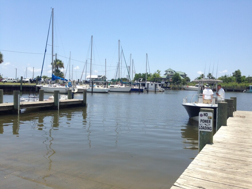fishing boats rest in a harbor on the Apalachicola Bay (2011).